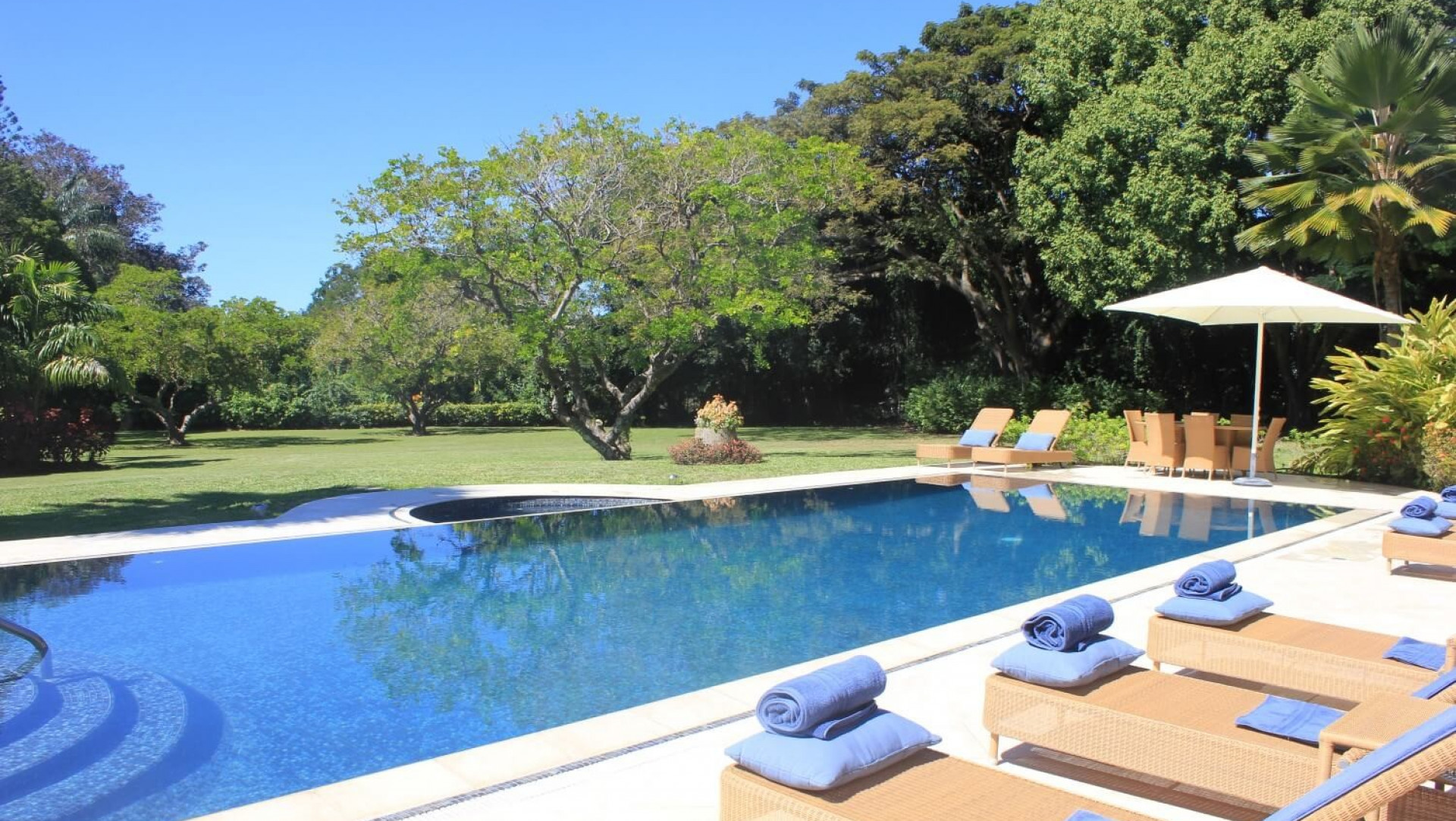 Outdoor Photo of Swimming Pool 6 Bedroom Villa in Sandy Lane with Private Pool & Tropical Garden